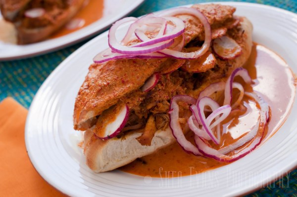 Torta-Ahogada-with-Pickled-Red-Onions-and-Refried-Beans